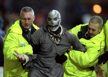 6 Nov 1999:  Halloween intruder is led away by stewards during the FA Carling Premiership match between Sheffield Wednesday and Watford at Hillsborough in Sheffield, England. \ Mandatory Credit: Mark Thompson /Allsport