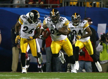 TAMPA, FL - FEBRUARY 01:  James Harrison #92 of the Pittsburgh Steelers runs back an interception for 100 yards to score a touchdown in the second quarter against the Arizona Cardinals during Super Bowl XLIII on February 1, 2009 at Raymond James Stadium i