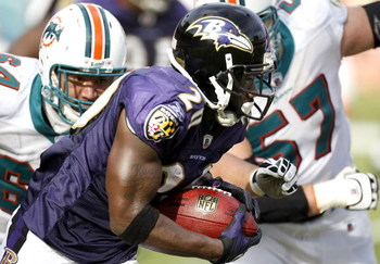 MIAMI - JANUARY 04:  Ed Reed #20 of the Baltimore Ravens looks for extra yards after his third quarter interception while playing the Miami Dolphins during a AFC Wild Card playoff game on January 4, 2009 at Dolphin Stadium in Miami, Florida. Baltimore won