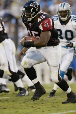 CHARLOTTE, NC - SEPTEMBER 28:  Running back T.J. Duckett #45 of the Atlanta Falcons carries the ball against the Carolina Panthers on September 28, 2003 at Ericsson Stadium in Charlotte, North Carolina. The Panthers defeated the Falcons 23-3. (Photo by Cr