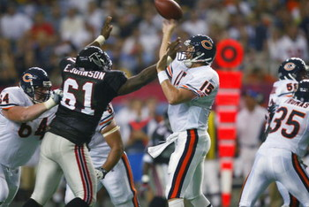 ATLANTA, GA - SEPTEMBER 15:  Quarterback Jim Miller #15 of the Chicago Bears throws a pass as he is blocked by Ellis Johnson #61 of the Atlanta Falcons on September 15, 2002  at the Georgia Dome in Atlanta, Georgia.  The Bears defeated the Falcons 14-13.