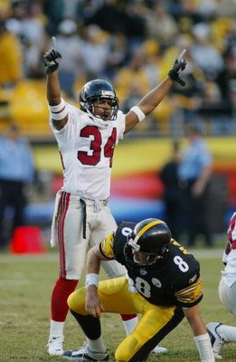 PITTSBURGH, PA - NOVEMBER 10:  Cornerback Ray Buchanan #34 of the Atlanta Falcons celebrates as quarterback Tommy Maddox #8 of the Pittsburgh Steelers picks himself up off the ground on November 10, 2002 at Heinz Field in Pittsburgh, Pennsylvania. The gam