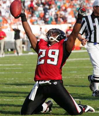 MIAMI - NOVEMBER 6:  Safety Keion Carpenter #29 of the Atlanta Falcons points toward the sky after recovering a key fumble that clinched the win over the Miami Dolphins on November 6, 2005 at Dolphins Stadium in Miami, Florida. The Falcons defeated the Do