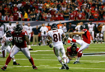 ATLANTA - OCTOBER 12:  Kicker Jason Elam #1 (R) of the Atlanta Falcons kicks the game-winning field goal with one second left over the Chicago Bears at the Georgia Dome on October 12, 2008 in Atlanta, Georgia.  (Photo by Kevin C. Cox/Getty Images)