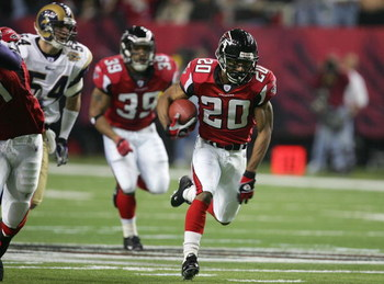 ATLANTA - JANUARY 15:  Allen Rossum #20 of the Atlanta Falcons runs against the defense of the St. Louis Rams during first half of the NFC Divisional Playoff game at the Georgia Dome on January 15, 2005 in Atlanta, Georgia.  (Photo by Streeter Lecka/Getty