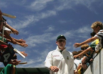 MELBOURNE, AUSTRALIA - DECEMBER 29:  (EDITORS NOTE: An on camera polarizing filter has been used in the creation of this image) Graeme Smith of South Africa leads his team from the field during day four of the Second Test between Australia and South Afric