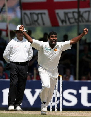 KANDY, SRI LANKA - DECEMBER 03:  Sri Lankan bowler Muttiah Muralitharan celebrates after taking his World Record 709th Test wicket, that of England batsman Paul Collingwood, during the third day of the First Test match between Sri Lanka and England at Asg