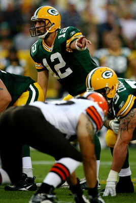 GREEN BAY, WI - AUGUST 15:  Quarterback Aaron Rodgers #12 of the Green Bay Packers under center against the Cleveland Browns during the preseason game at Lambeau Field on August 15, 2009 in Green Bay, Wisconsin.  (Photo by Jonathan Daniel/Getty Images)