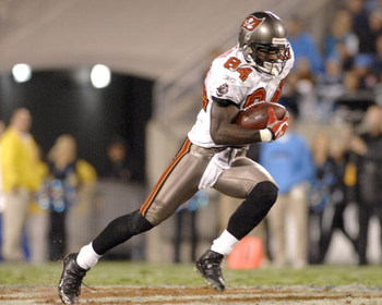 Tampa Bay Buccaneers wide receiver Joey Galloway grabs a midfield pass against the Carolina Panthers  on ESPN Monday Night Football Nov. 13, 2006 in Charlotte.  The Panthers won 24 - 10.  (Photo by Al Messerschmidt/Getty Images)