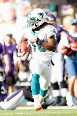 MIAMI - JANUARY 4:  Davone Bess #15 of the Miami Dolphins carries the ball during an AFC Wild Card playoff game against the Baltimore Ravens on January 4, 2009 at Dolphin Stadium in Miami, Florida. (Photo by Gregory Shamus/Getty Images)