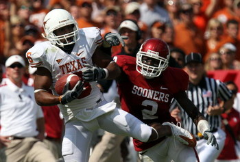 DALLAS - OCTOBER 11:  Wide receiver Quan Cosby #6 the Texas Longhorns makes a pass reception against Brian Jackson #2 of the Oklahoma Sooners during the Red River Rivalry at the Cotton Bowl on October 11, 2008 in Dallas, Texas.  (Photo by Ronald Martinez/