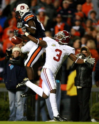AUBURN, AL - NOVEMBER 24:  Defensive back Kareem Jackson #3 of the Alabama Crimson Tide reaches back to knock down a pass intended for Rodgeriqus Smith #80 of the Auburn Tigers at Jordan-Hare Stadium on November 24, 2007 in Auburn, Alabama. (Photo by Doug