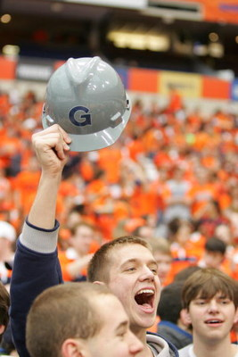 SYRACUSE, NY - FEBRUARY 16:  A Georgetown fan cheers for the Hoyas during the game between the Georgetown University Hoyas and the Syracuse University Orange at the Carrier Dome February 16, 2008 in Syracuse, New York. (Photo by Marc Squire/Getty Images)