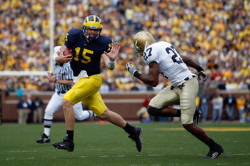 ANN ARBOR, MI - SEPTEMBER 15:  Ryan Mallett #15 of the Michigan Wolverines scrambles against David Bruton #27 of the Notre Dame Fighting Irish on September 15, 2007 at Michigan Stadium in Ann Arbor, Michigan. Michigan won 38-0. (Photo by Gregory Shamus/Ge
