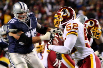 LANDOVER, MD - NOVEMBER 16:  Rocky McIntosh #52 of the Washington Redskins runs the ball against Marc Colombo #75 of the Dallas Cowboys after catching an interception during the game on November 16, 2008 at FedEx Field in Landover, Maryland.  (Photo by Ji