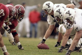 21 Nov 1998:  General view of the Harvard Crimson defensive line (left) lined up against the offensive line of the Yale Bulldogs during the game at the Harvard Stadium in Cambridge, Massachusetts. The Bulldogs defeated the Crimson 9-7. Mandatory Credit: A