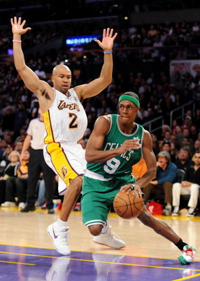 LOS ANGELES, CA - DECEMBER 25:   Rajon Rondo #9 of the Boston Celtics drives to the basket against Derek Fisher #2 of the Los Angeles Lakers at Staples Center on December 25, 2008 in Los Angeles, California.  The Lakers defeated the Celtics 92-83.  NOTE T