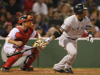 BOSTON - SEPTEMBER 26:  Robinson Cano #24 of the New York Yankees drives in two runs as Kevin Cash #30 of the Boston Red Sox catches on September 26, 2008 at Fenway Park in Boston, Massachusetts.  (Photo by Elsa/Getty Images)