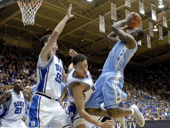 DURHAM, NC - FEBRUARY 07:  David McClure #14 of the Duke University Blue Devils fouls Marcus Ginyard #1 of the North Carolina Tar Heels during their game on February 7, 2007 at Cameron Indoor Stadium in Durham, North Carolina.  (Photo by Grant Halverson/G