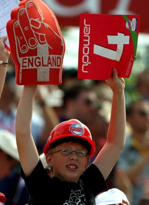SOUTHAMPTON, UNITED KINGDOM - JULY 26:  A young fan waves a 4 sign and wears a hard hat during the Twenty20 Cup Semi Final between Kent and Essex at The Rosebowl on July 26, 2008 in Southampton, England.  (Photo by Richard Heathcote/Getty Images)
