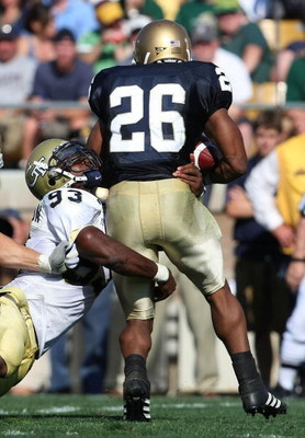 SOUTH BEND, IN - SEPTEMBER 01: Travis Thomas #26 of the Notre Dame Fighting Irish is tackled for a loss by Michael Johnson #93 of the Georgia Tech Yellow Jackets on September 1, 2007 at Notre Dame Stadium in South Bend, Indiana. (Photo by Jonathan Daniel/