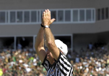 TAMPA, FL - OCTOBER 13: NCAA referee Gil Gelbke signals a two-point safety as the University of South Florida Bulls host the University of Central Florida Knights at Raymond James Stadium on October 13, 2007 in Tampa, Florida. The Bulls won 64 - 12. (Phot