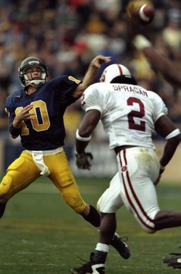 21 Nov 1998:  Quarterback Justin Vedder #10 of the California Golden Bears in action against linebacker Donnie Spragan #2 of the Stanford Cardinal during the game at the Memorial Stadium in Berkeley, California. The Cardinal defeated the Golden Bears 10-3
