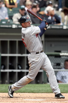 CHICAGO - MAY 08:  Michael Cuddyer #5 of the Minnesota Twins swings at a pitch during the game against the Chicago White Sox on May 8, 2008 at U.S. Cellular Field in Chicago, Illinois. (Photo by Jonathan Daniel/Getty Images)