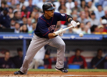 NEW YORK - JULY 22:  Carlos Gomez #22 of the Minnesota Twins attempts a bunt against the New York Yankees at Yankee Stadium July 22, 2008 in the Bronx borough of New York City.  (Photo by Jim McIsaac/Getty Images)