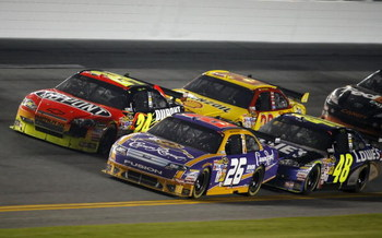 DAYTONA BEACH, FL - FEBRUARY 07:  Jamie McMurray, driver of the #26 Crown Royal Ford, races with Jeff Gordon, driver of the #24 DuPont Chevrolet, Kevin Harvick, driver of the #29 Shell/Pennzoil Chevrolet, and Jimmie Johnson, driver of the #48 Lowe's Chevr