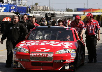 DAYTONA BEACH, FL - FEBRUARY 07:  Crew of the #14 Office Depot/Old Spice Chevrolet driven by Tony Stewart during practice for the NASCAR Sprint Cup Series Daytona 500 at Daytona International Speedway on February 7, 2009 in Daytona Beach, Florida.  (Photo