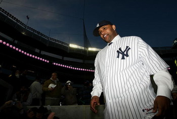 NEW YORK - DECEMBER 18:  CC Sabathia walks off the field after a press conference to announce his signing to the New York Yankees at Yankee Stadium on December 18, 2008  in the Bronx borough of New York City.  (Photo by Nick Laham/Getty Images)