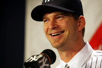 NEW YORK - DECEMBER 18:  A.J. Burnett talks to the media during a press conference to announce his signing to the New York Yankees at Yankee Stadium on December 18, 2008  in the Bronx borough of New York City.  (Photo by Nick Laham/Getty Images)