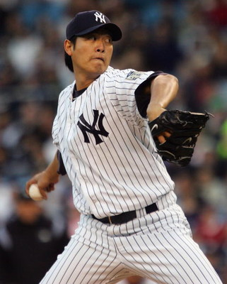 NEW YORK - APRIL 16: Chien-Ming Wang #40 of the New York Yankees pitches against the Boston Red Sox on April 16, 2008 at Yankee Stadium in the Bronx borough of New York City. The Yankees won the game 15-9. (Photo by Jim McIsaac/Getty Images)
