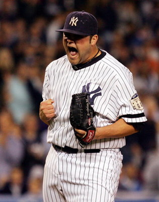 NEW YORK - SEPTEMBER 19:  Joba Chamberlain #62 of the New York Yankees reacts after striking out the side in the eigth inning against the Baltimore Orioles on September 19, 2008 at Yankee Stadium in the Bronx borough of New York City. The Yankees defeated