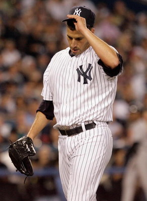 NEW YORK - SEPTEMBER 21: Andy Pettitte #46 of the New York Yankees pitches against the Baltimore Orioles during the last regular season game at Yankee Stadium on September 21, 2008 in the Bronx borough of New York City. The Yankees are playing their final