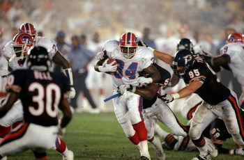 21 Aug 1998:  Running back Thurman Thomas #34 of the Buffalo Bills in action against linebacker Andre Collins #52 and defensive end Mark Thomas #95 of the Chicago Bears during the pre-season game at Soldier Field in Chicago, Illinois. The Bills defeated t