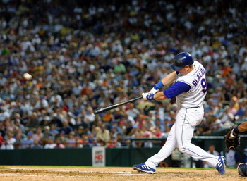 ARLINGTON, TX - JULY 19: Hank Blalock #9 of the Texas Rangers hits a two run homerun against the New York Yankees on July 19, 2005 at Ameriquest Field in Arlington in Arlington, Texas.  The Rangers defeated the Yankees 2-1.  (Photo by Ronald Martinez/Gett