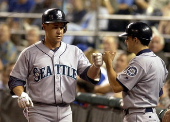 KANSAS CITY, MO - AUGUST 17:  Bret Boone #29 of the Seattle Mariners gets congratulated by the Mariner's batboy after he hit a solo homer against the Kansas City Royals on August 17, 2004 at Kauffman Stadium in Kansas City, Missouri.  (Photo by Dave Kaup/