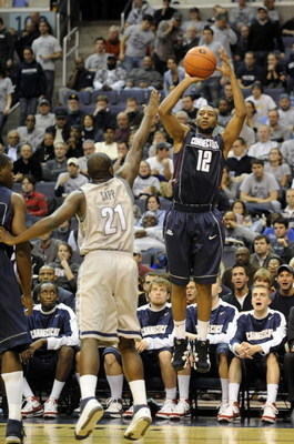 WASHINGTON - JANUARY 12:   A.J. Price #12 of the University of Connecticut takes a jump shot against the Georgetown Hoyas at the Verizon Center on January 12, 2008 in Washington, D.C. (Photo by Greg Fiume/Getty Images)