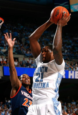 CHAPEL HILL, NC - FEBRUARY 07:  Deon Thompson #21 of the North Carolina Tar Heels grabs a rebound against Jeff Jones #23 of the Virginia Cavaliers during the game on February 7, 2009 at the Dean E. Smith Center in Chapel Hill, North Carolina.  (Photo by K