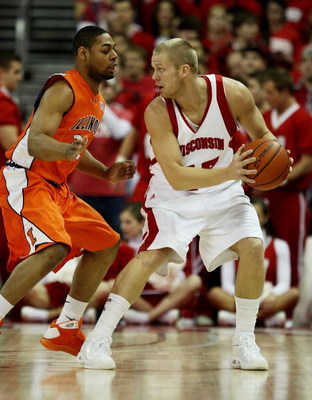 MADISON, WI - FEBRUARY 05: Joe Krabbenhoft #45 of the Wisconsin Badgers looks to pass under pressure from Demetri McCamey #32 of the Illinois Fighting Illini on February 5, 2009 at the Kohl Center in Madison, Wisconsin. Wisconsin defeated Illinois 63-50.
