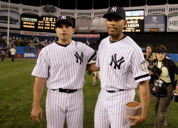NEW YORK - SEPTEMBER 21: Ivan Rodriguez #12 (L) and Mariano Rivera #42 of the New York Yankees stand on the field after the last regular season game at Yankee Stadium on September 21, 2008 in the Bronx borough of New York City. The Yankees are playing the