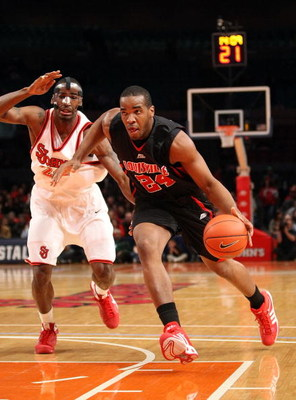 NEW YORK - FEBRUARY 08:  Samardo Samuels #24 of the Louisville Cardinals drives to the basket against Justin Burrell #24 of St John's Red Storm on February 8, 2009 at Madison Square Garden in New York City, New York.  (Photo by Nick Laham/Getty Images)