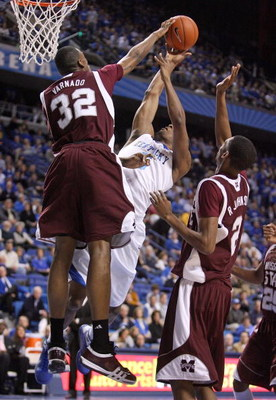 LEXINGTON, KY - FEBRUARY 3:  Jarvis Varnado #32 of the Mississippi State Bulldogs blocks the shot of Ramon Harris #5 of the Kentucky Wildcats during the SEC game at Rupp Arena February 3, 2009 in Lexington, Kentucky. Mississippi State won 66-57.  (Photo b