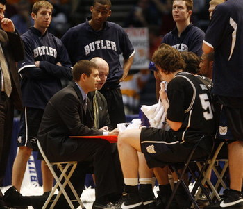 BIRMINGHAM, AL - MARCH 23:  Coach Brad Stevens of the Butler Bulldogs talks with his team during a game against the Tennessee Volunteers during the second round of the East Regional as part of the 2008 NCAA Men's Basketball Tournament at the Birmingham-Je