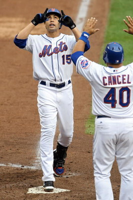 NEW YORK - SEPTEMBER 28:  Carlos Beltran #15 celebrats with Robinson Cancel #40 of the New York Mets after hitting a two run home run against the Florida Marlins during the last regular season baseball game ever played in Shea Stadium on September 28, 200
