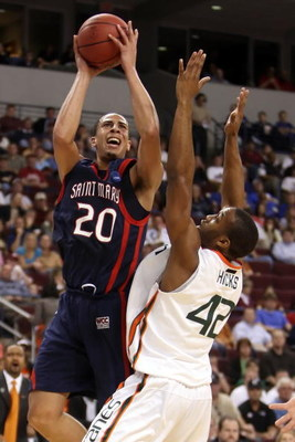 NORTH LITTLE ROCK, AR - MARCH 21:  Diamon Simpson #20 of the Saint Mary's Gaels shoots over Raymond Hicks #42 of the Miami Hurricanes during the first round of the South Regional as part of the 2008 NCAA Men's Basketball Tournament at Alltel Arena on Marc