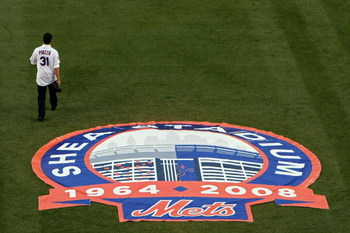 NEW YORK - SEPTEMBER 28:  Former Mets catcher Mike Piazza walks on the field in a post game ceremony after the last regular season baseball game ever played in Shea Stadium against the Florida Marlins on September 28, 2008 in the Flushing neighborhood of