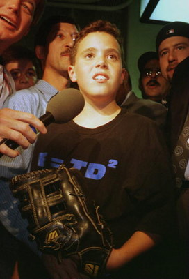9 Oct 1996: An interviewer speaks to Yankees fan Jeffrey Maier, the twelve year old who caught a fly ball to right field over outfielder Tony Tarasco of the Baltimore Orioles that was ruled a home run in a controversial decision during the first game of t